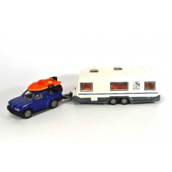 Opel Frontera with caravan and boat