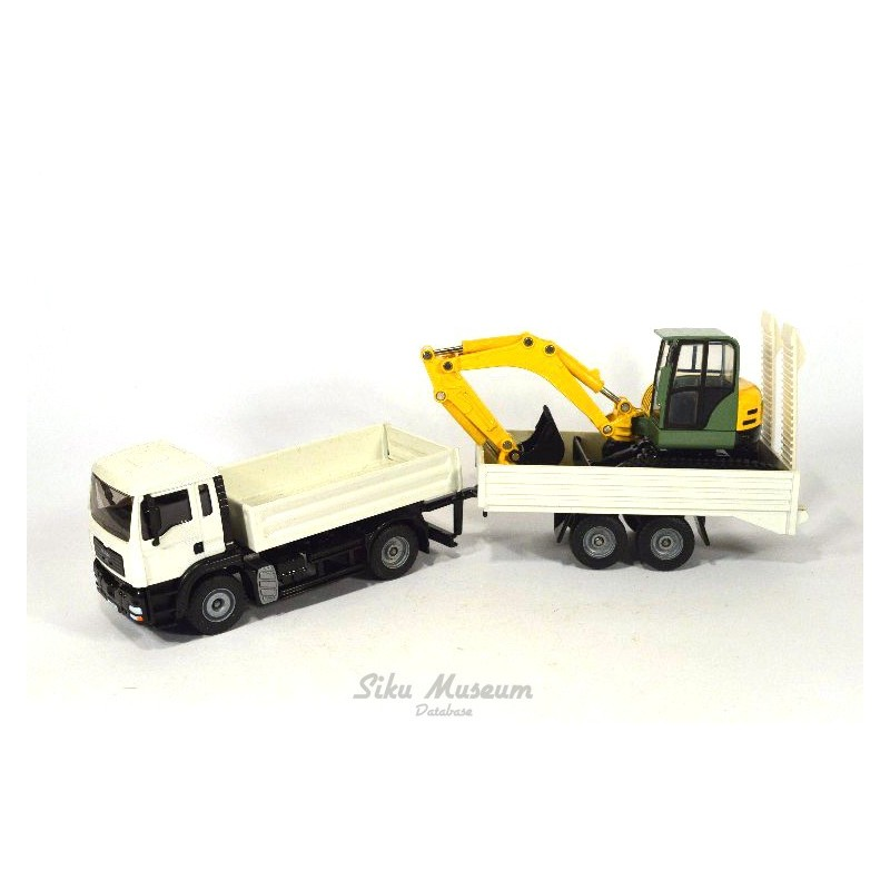 MAN TGA with Schaeff  HR32 excavator