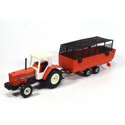 Massey Ferguson with hay trailer